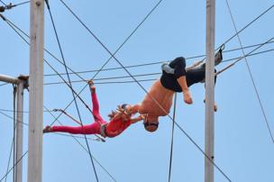 People practising on a trapeze