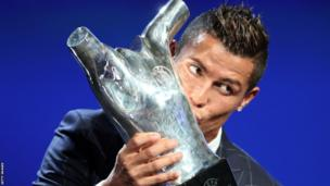Cristiano Ronaldo was named Uefa Best Player in Europe for a second time - and celebrated by kissing the trophy