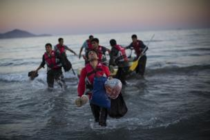 Migrants from Pakistan land on shore in Kos, Greece after completing a journey in a small dinghy crossing a three mile stretch of the Aegean Sea from Turkey.