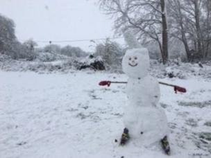 Snowman in the garden with rollerblades