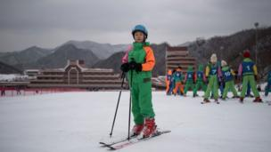 In this photo taken on February 19, 2017, Pak Han-Song, 11, poses for a portrait on a beginner's slope at the Masikryong
