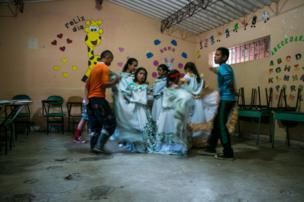 Children practice a cultural dance in Santa Lucia's school, July 2016