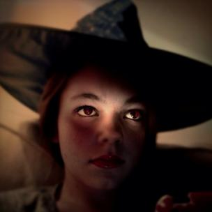 Girl in witches hat