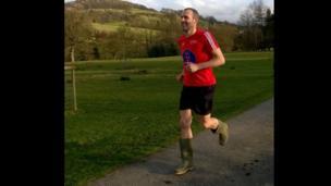 Runner in Wellington boots