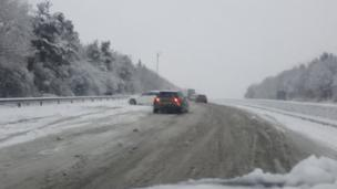 cars on the motorway in the snow