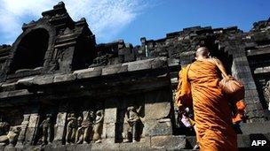 Buddhist monks walk into temple of Borobudur, Indonesia, during Vesak Day celebrations, May 2010