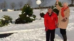 Enid Williamson and Myrtle Gibb get in a spot of snowballing in Dromore, County Down