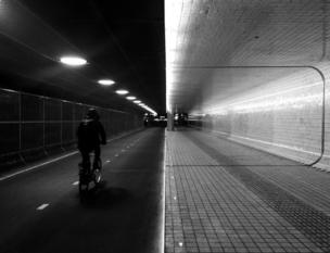 A tunnel with half for pedestrians, another for cyclists
