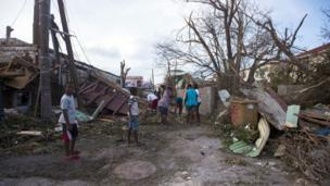 People clear wreckage in a street in Marigot on the French Caribbean island of Saint-Martin. 7 Sept 2017