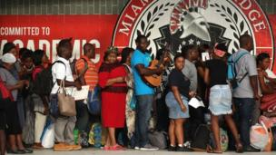 People wait to enter South Ridge high school in Miami