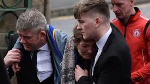Morgan Barnard's mother Marie is comforted at her son's funeral service