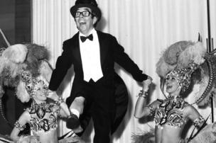 Corbett appeared many times on stage - here dancing with two cabaret dancers during a rehearsal for a two week season at the Savoy Hotel, London, in 1970