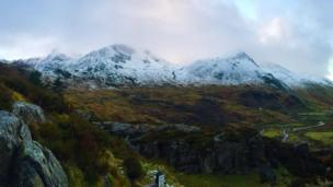 Snow-capped mountains over Ogwen Valley in Snowdonia