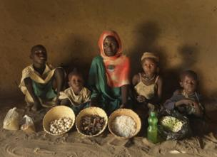 Jumana and her family with their weekly food