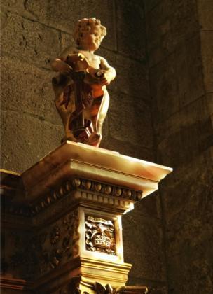A cherub on a plinth