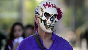 A woman takes part in a march on 19 October 2016 in Mexico City