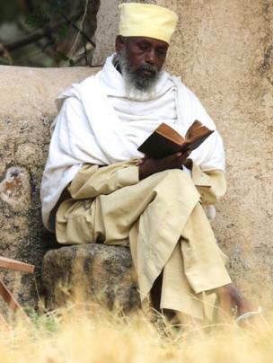An Ethiopian monk reads the Bible