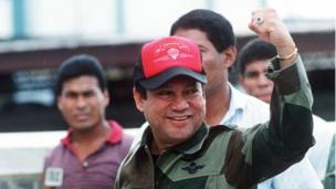 This 04 October, 1989, file photo shows former Panamanian strongman General Manuel Noriega waving as he left his headquarters in Panama City following a failed coup against him.