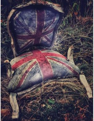 A rotting chair upholstered with the union flag