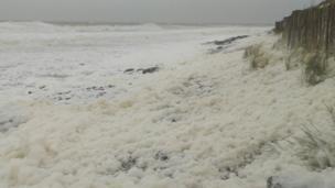 Sea foam at Llandanwg beach, near Harlech
