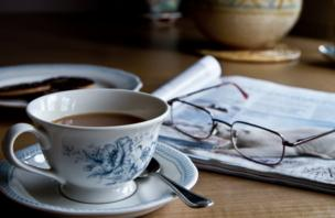 A cup of tea, newspaper and glasses
