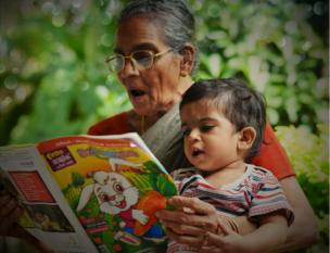 A grandmother reads to her grandson