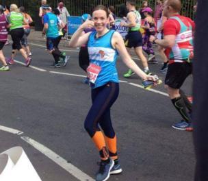 Laura Main gives the thumbs up, half way through the London marathon