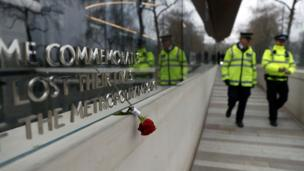 A floral tribute is seen outside New Scotland Yard following a recent attack in Westminster, in London, Britain.