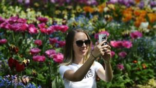Woman taking selfie in St James's Park