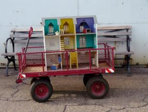 Toy house in a wheeled cart