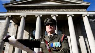 Captain Peter Kelleher from the 27th Infantry Battalion reads the Proclamation at the GPO
