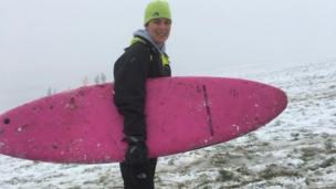 Lyn Ward with surf board