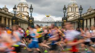 Runners pass by the Old Naval College in Greenwich