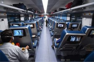 In this photograph taken on May 22, 2017, Indian passengers travel onboard the Tejas Express luxury train during its first journey between Mumbai and Goa in Mumbai