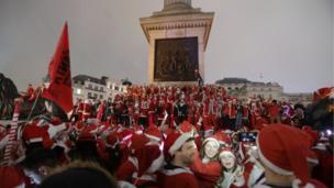 Revellers in Trafalgar Square, London, taking part in the Santacon Christmas parade. 10 December 2016