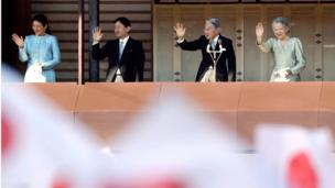 Japan's Emperor Akihito, third from left, waves with Empress Michiko, right, Crown Prince Naruhito and Crown Princess Masako, to well-wishers from a balcony during a New Year's public appearance at the Imperial Palace in Tokyo. 2 January 2014.
