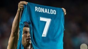 Ronaldo holds up shirt