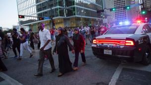 Protesters marching along a street in the central business district of Dallas - 7 July 2016