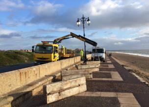 Workers repairing the promenade at Southsea, Hampshire