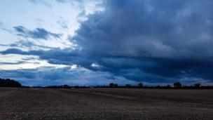Approaching rain clouds near Combe.