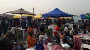 People dey siddon for di festival
