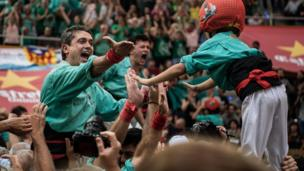 "Members of the colla ""Castellers de Vilafranca"" celebrate after building a human tower during the 26th Tarragona Competition on October 2, 2016 in Tarragona, Spain."