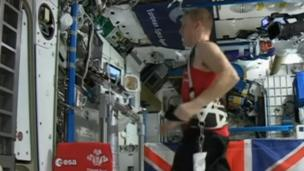 Major Tim Peake runs 26.2 miles on a treadmill in space