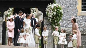Duchess of Cambridge stands with her children Prince George and Princess Charlotte, following the wedding of her sister Pippa Middleton to James Matthews