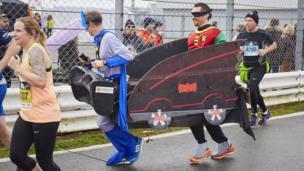 Runners dressed as Batmobile