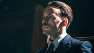 Sam Claflin as Sir Oswald Mosley up in Peaky Blinders