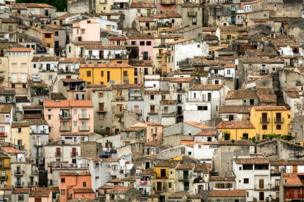 in_pictures Houses built on the steep hillside in Sicily, Italy.