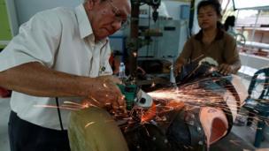 Engineers adjust the prosthetic elephant leg