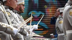 Drummers beating drums through streets of Belfast, 12 July 2017