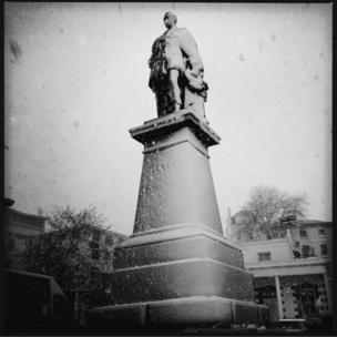 A black and white image of a statue